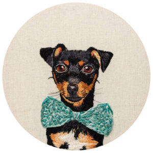 fine art print reproduction of an embroidery of a jack Russell puppy