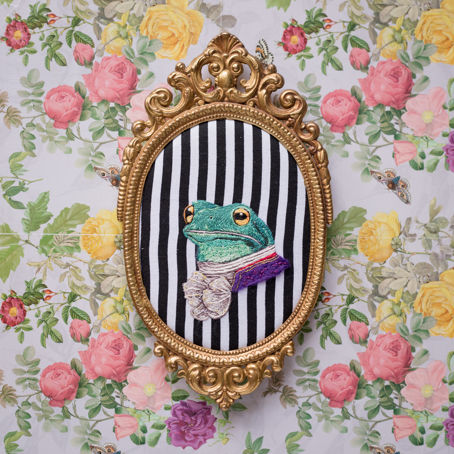 Embroidered Portrait of Frog dress in Victorian clothes within a gold frame